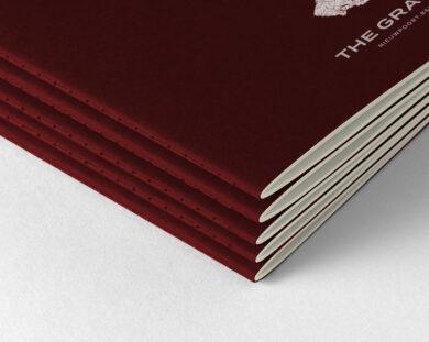 The Grand notitieboekje piled v2